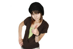Woman in black beret. Portrait of an elegant brunette woman in black beret pointing at the camera , white background stock image