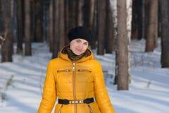 Woman in black beret b yellow jacke Stock Image