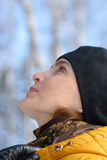 Woman in black beret and a yellow jacket. Stock Photos