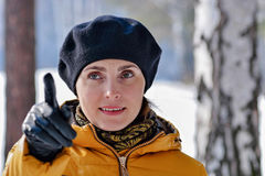 Woman in a black beret and a yellow jacket. Stock Photos