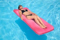 Woman in black bikini royalty free stock photo