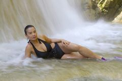 Woman with black bikini sexy in waterfall. At Erawan Waterfall and  natural in Kanchanaburi province, Thailand stock images