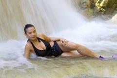 Woman and black bikini shape sexy in waterfall. At Erawan Waterfall and  natural in Kanchanaburi province, Thailand stock photos