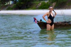 Woman black bikini show relax on beach Stock Image