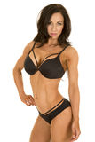 Woman in black bikini standing hand on hip Royalty Free Stock Images
