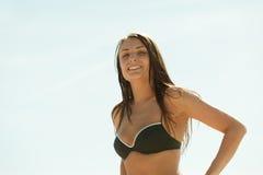 Woman in black bikini swimsuit having fun outside Stock Photography