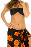 Woman in black bikini top and sarong around waist body Stock Images
