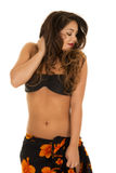 Woman in black bikini top and sarong around waist look side Royalty Free Stock Photography
