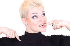 Woman in black biting her finger. Over white royalty free stock photos
