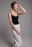 Woman in black blouse and white trousers Stock Photos