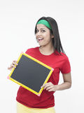 Woman with a black board Stock Image