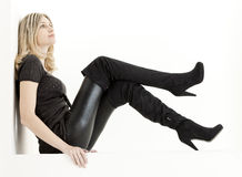Woman with black boots Stock Photo