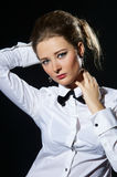 Woman and black bow-tie Stock Photography