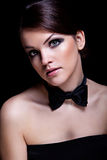 Woman and black bow-tie Royalty Free Stock Photography