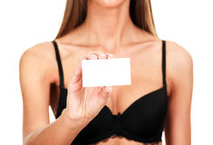 Woman in black bra shows empty card Stock Photography
