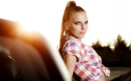 Woman on black  cabriolet Royalty Free Stock Photography