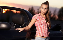 Woman on black  cabriolet Royalty Free Stock Images