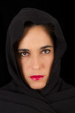 Woman in black cape with sad face Stock Images