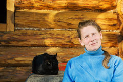 Woman with black cat Royalty Free Stock Image