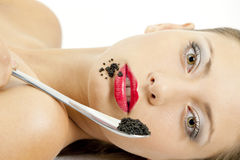 Woman with black caviar Stock Photos