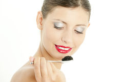 Woman with black caviar Stock Photography