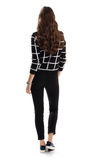 Woman in black checkered sweater. Royalty Free Stock Photos
