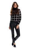 Woman in black checkered sweatshirt. Stock Images