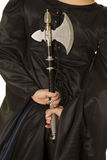 Woman in black cloak body back with hatchet Stock Photos