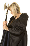 Woman in black cloak hatched by head eyes closed Royalty Free Stock Photo