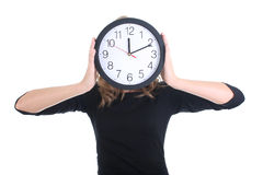Woman in black with clock Stock Image