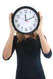 Woman in black with clock Stock Photography