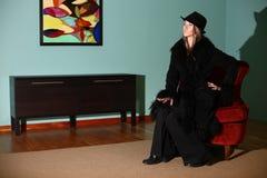 Woman in black coat Stock Image