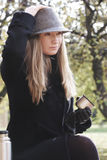 Woman in black coat and hat Royalty Free Stock Image