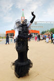 Woman in black costume poses during street theaters show at open air festival White Nights Stock Images