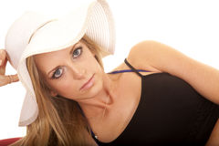 Woman black cover up white hat close looking Royalty Free Stock Photo