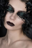 Woman with black creative makeup Stock Image