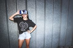 Woman in Black Crew-neck T-shirt Wearing Blue Vr Goggles stock photo
