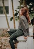 Woman in Black Distress Jeans Sitting on Pillar Photo Royalty Free Stock Image