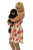 Woman with pekingese dog Stock Image