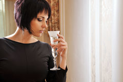 Woman in black dress. Portrait of a woman with a glass of champagne Royalty Free Stock Image
