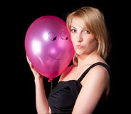 Woman in black dress  with air ball over dark background Royalty Free Stock Photos