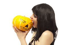 Woman in black dress biting a pumpkin Stock Image