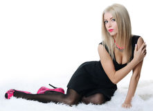 Woman in a black dress on a carpet Royalty Free Stock Photography