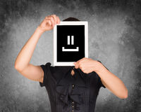 Woman in black dress covered her face with tablet Royalty Free Stock Photography