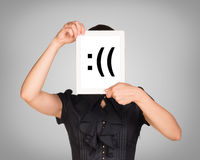 Woman in black dress covered her face with tablet Stock Photo