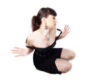 Woman in black dress fishnet stockings Stock Image