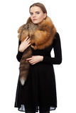 Woman in black dress with a fur collar Stock Photos