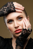 Woman in black dress and gloves. Stock Image