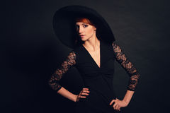Woman in black dress and hat Stock Images