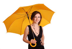 Woman in black dress hold yellow umbrella Stock Photos